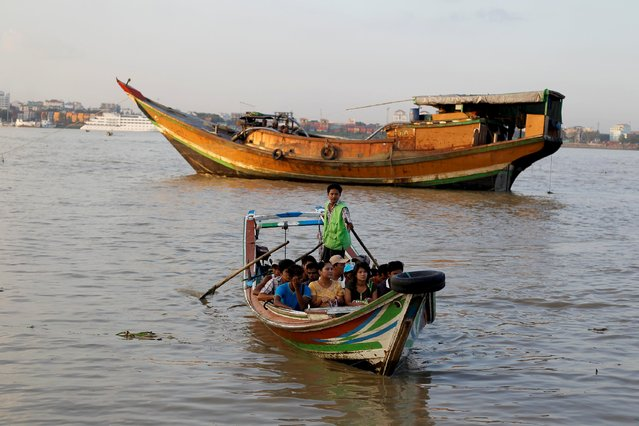 People ride on a boat as they cross the Yangon river October 23, 2015. (Photo by Soe Zeya Tun/Reuters)