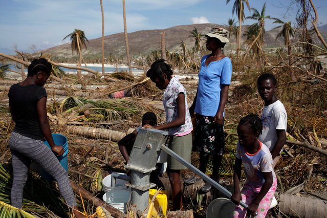 People get water with a water pump after Hurricane Matthew in Coteaux, Haiti, October 9, 2016. (Photo by Andres Martinez Casares/Reuters)