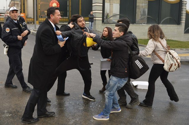 Security officers (L) scuffle with students during a protest outside the Presidential Palace in Ankara December 17, 2014. Opposition groups held anti-government protests in Ankara and across Turkey on the first anniversary of the corruption probe which became public with police raids on December 17 last year. (Photo by Reuters/Stringer)