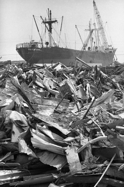 The freighter silver hawk, beached at Gulfport, Miss., on August 3, 1970 by hurricane Camille, appears to be adrift on a sea of debris. The silver hawk was one of two cargo ships run aground by the 200-mile-per-hour hurricane. Both, still there almost a year later, are yielding to the blowtorch as crews dismantle them. (Photo by Jack Thornell/AP Photo)