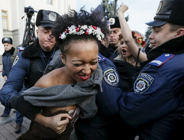 Ukrainian police detain activists of women's rights group Femen as they protest against homophobia outside the parliament building in Kiev, Ukraine, November 12, 2015. (Photo by Gleb Garanich/Reuters)