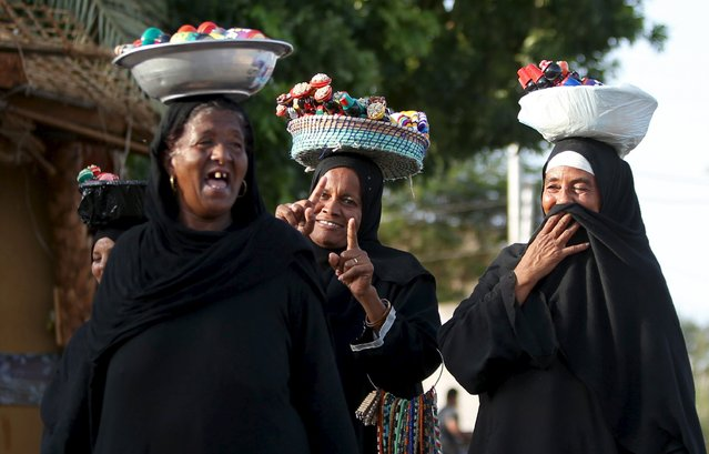 Nubian women sell traditional handicrafts at the Nubian Gharb Suheil village, near Aswan south of Egypt, October 1, 2015. For half a century, Egypt's Nubians have patiently lobbied the government in Cairo for a return to their homelands on the banks of the upper Nile, desperate to reclaim territory their ancestors first cultivated 3,000 years ago. (Photo by Mohamed Abd El Ghany/Reuters)
