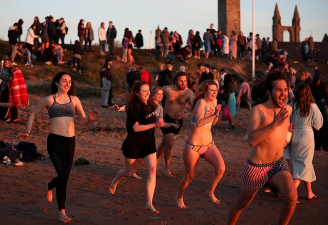 Students from the University of St Andrews take part in the traditional May Day Dip on the East Sands in St Andrews, Fife, Scotland on May 1, 2018. (Photo by Jane Barlow/PA Images via Getty Images)