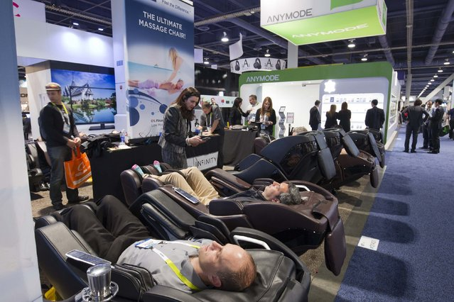 Attendees take a break at the Infinity Massage Chair booth during the 2015 International Consumer Electronics Show (CES) in Las Vegas, Nevada January 6, 2015. (Photo by Steve Marcus/Reuters)