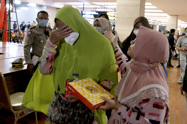 Relatives of Sriwijaya Air plane passengers arrive at the crisis center in Soekarno-Hatta International Airport following the report that Sriwijaya Air plane flight SJ182 lost contact shortly after taking off, at Tanjung Priok Port in Jakarta, Indonesia, 09 January 2021. According to an airline spokesperson, contact to Sriwijaya Air flight SJ182 was lost on 09 January 2021 shortly after the aircraft took off from Jakarta International Airport while en route to Pontianak in West Kalimantan province. A search and rescue operation is under way. (Photo by Mast Irham/EPA/EFE)