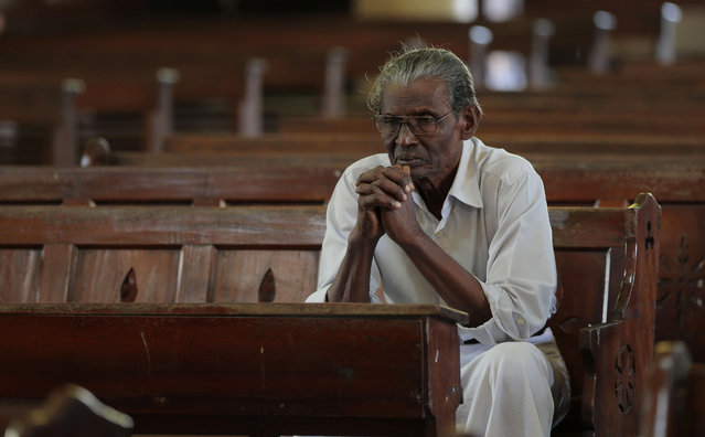 In this Wednesday, January 7, 2015 photo, a Sri Lankan Catholic devotee prays at a church in Colombo, Sri Lanka. (Photo by Eranga Jayawardena/AP Photo)