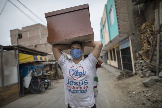 A worker, a migrant from Venezuela, carries a newly made coffin for victims of COVID-19, to a storeroom at a coffin factory in the Juan de Lurigancho neighborhood of Lima, Peru, Thursday, June 4, 2020. As the number of COVID-19 deaths in Peru rapidly mounts, the South American country is becoming one of the epicenters for the virus outbreak in Latin America. (Photo by Rodrigo Abd/AP Photo)