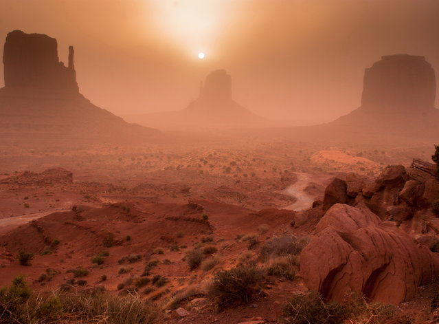 """Monument Valley Sandstorm Sunrise"". Arriving at Monument Valley in the middle of a sandstorm, created some pretty eerie effects. Location: Monument Valley, UT. (Photo and caption by Robert Skerman/National Geographic Traveler Photo Contest)"