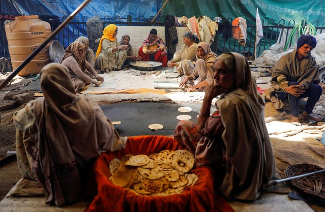 Women prepare meals at a site of a protest against the farm laws in New Delhi, India, January 30, 2021. (Photo by Adnan Abidi/Reuters)