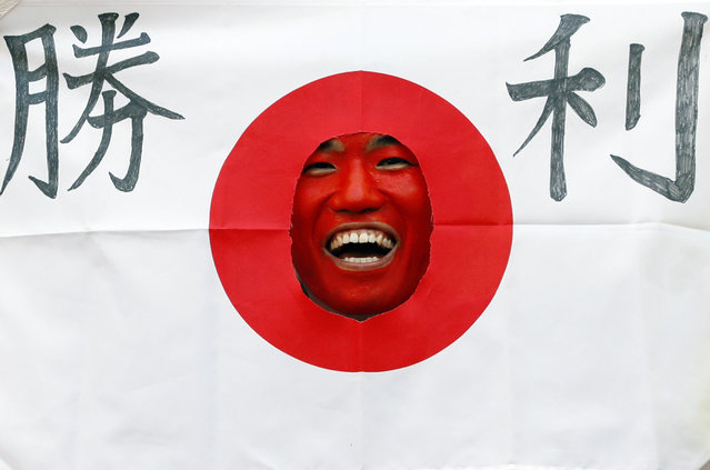 A Japan fan laughs before the Russia 2018 World Cup Group H football match between Colombia and Japan at the Mordovia Arena in Saransk on June 19, 2018. (Photo by Jack Guez/AFP Photo)