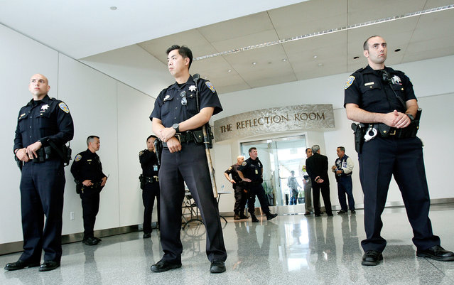 Police guard the Reflection Room at the international terminal, where passengers from the Asiana Airlines flight that crash-landed were reportedly gathering at San Francisco International Airport July 6, 2013 in San Francisco, California. A Boeing 777 Asiana Airlines passenger aircraft coming from Seoul, South Korea crashed while landing. There has been no official confirmation of casualties. (Photo by Sarah Rice/Getty Images)