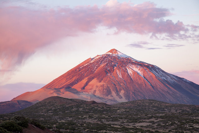 Sunrise over Teide National Park with a cloud on top of Teide volcano, Teide National Park, Tenerife, Spain on September 30, 2016. (Photo by Santiago Urquijo/Getty Images)