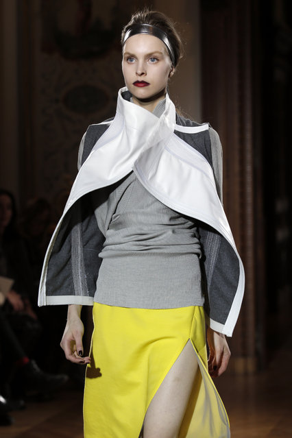 A model wears a creation by fashion designer Gustavo Lins during his Spring-Summer 2015 Haute Couture fashion collection presented in Paris, France, Tuesday, Jan. 27, 2015. (AP Photo/Francois Mori)
