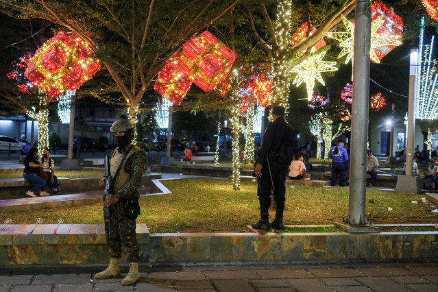 A soldier stands near Christmas lights decoration at the Libertad square, as the coronavirus disease (COVID-19) outbreak continues, in San Salvador, El Salvador on December 22, 2020. (Photo by Jose Cabezas/Reuters)
