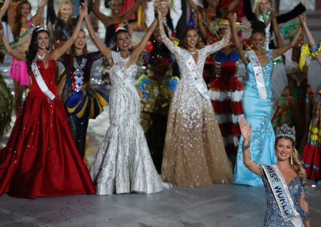 Miss Spain, Mireia Lalaguna Royo (bottom R) waves after winning the Miss World title during the grand final of the 65th Miss World pageant at the Beauty Crown Hotel Complex  in Sanya, Hainan Province of China, 19 December 2015. Miss Spain, Mireia Lalaguna Royo (C) wins the top title at the grand finals of Miss World pageant. (Photo by How Hwee Young/EPA)