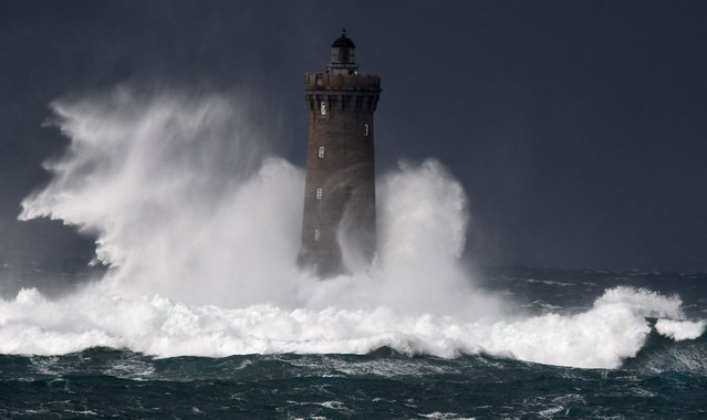 High waves and strong winds hit The Four Lighthouse (Lighthouse of the Four d'Argenton)  at Porspoder, western France on December 27, 2020, as Storm Bella strikes the coast of Britanny. (Photo by Fred Tanneau/AFP Photo)