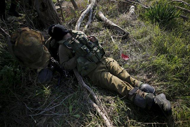 An Israeli soldier rests during military activity across from the Israeli-Gaza border in southern Israel January 13, 2016. (Photo by Amir Cohen/Reuters)