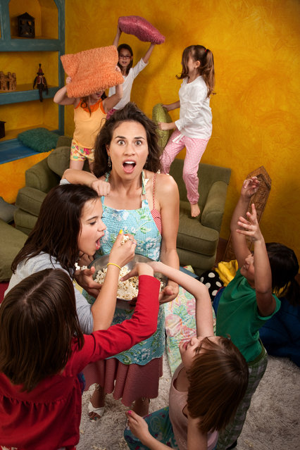 Shocked mother among wild little girls at a sleepover. (Photo by Getty Images/iStockphoto)