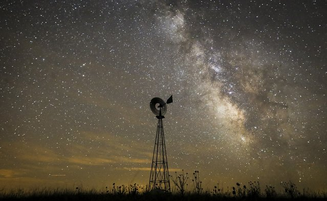This July 23, 2014 file photo shows the Milky Way galaxy on a moonless night from a cattle pasture in the Sand Hills of Nebraska. Our solar system lies at the edge of a structure called the Local Arm or the Orion Spur, and according to a paper released Wednesday, Sept. 28, 2016, researchers calculated that it stretches more than 20,000 light-years long, maybe about four times what scientists had thought before. (Photo by Travis Heying/The Wichita Eagle via AP Photo)
