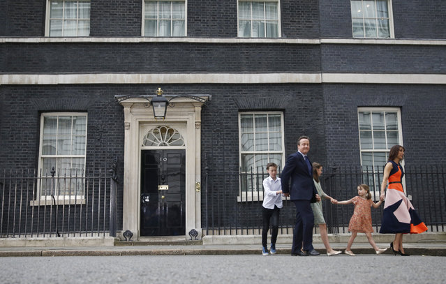 Britain's outgoing Prime Minister, David Cameron, accompanied by his wife Samantha, daughters Nancy (C) and Florence and son Arthur, leaves number 10 Downing Street, on his last day in office as Prime Minister, in central London, Britain July 13, 2016. (Photo by Stefan Wermuth/Reuters)