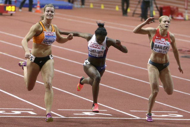 Dafne Schippers of the Netherlands wins the women's 60 metres final ahead second placed Dina Asher-Smith of Britain and third placed Verena Sailer of Germany (L-R) during the European Indoor Championships in Prague March 8, 2015. REUTERS/David W Cerny (CZECH REPUBLIC  - Tags: SPORT ATHLETICS)