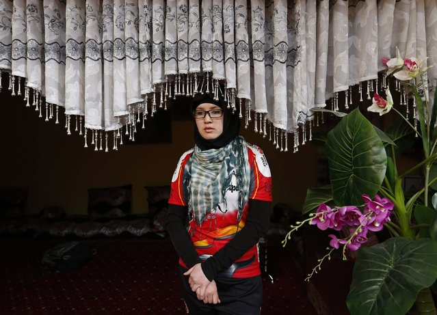 Zahra Alizada, a member of Afghanistan's Women's National Cycling Team stands in a house in Kabul February 20, 2015. (Photo by Mohammad Ismail/Reuters)