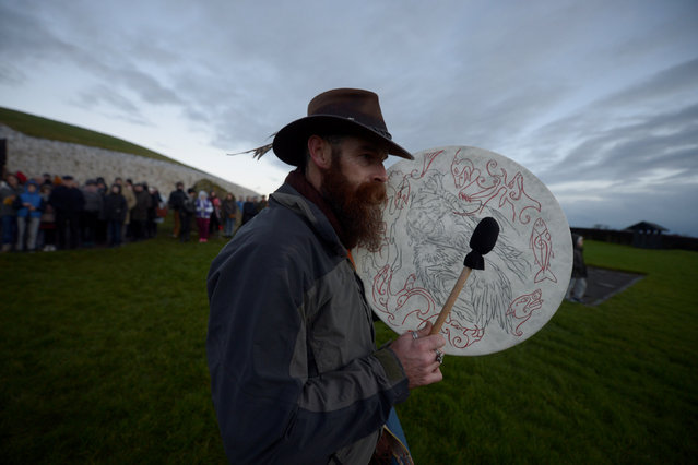 A reveller plays the bodhran drum during winter solstice at the 5000 year old stone age tomb of Newgrange in the Boyne Valley at sunrise in Newgrange, Ireland, December 21, 2016. (Photo by Clodagh Kilcoyne/Reuters)