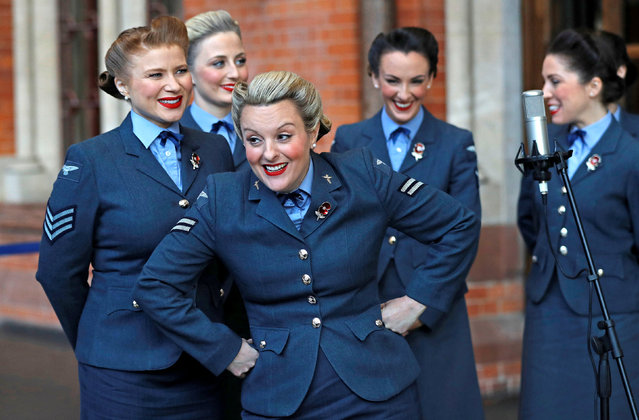 The singing group The D-Day Darlings take part in the unveiling ceremony of a permanent war memorial, created by artist and writer Fabian Peake, at St Pancras International railway station in London, Britain, November 8, 2018. (Photo by Peter Nicholls/Reuters)