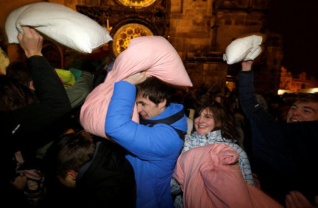 People take part in a four-minute flash mob pillow fight at the Old Town Square in Prague, Czech Republic, December 22, 2016. (Photo by David W. Cerny/Reuters)