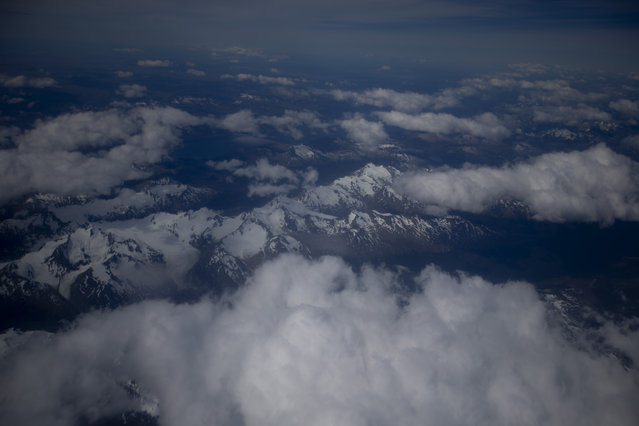 This January 20, 2015 aerial photo, shows the terrain that is seen on a flight from Punta Arenas to King George Island, Antarctica. No matter how tourists arrive, weather delays are the norm. During the recent patch of heavy fog, for six days planes were unable to take off or land on King George, leaving guides to deal with frustrated tourists. (Photo by Natacha Pisarenko/AP Photo)