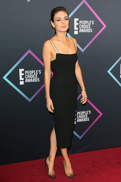 Mila Kunis, nominee for The Comedy Movie Star of 2018, arrives for the People's Choice Awards 2018 at Barker Hangar, in Santa Monica, California, on November 11, 2018. (Photo by Jean-Baptiste Lacroix/AFP Photo)