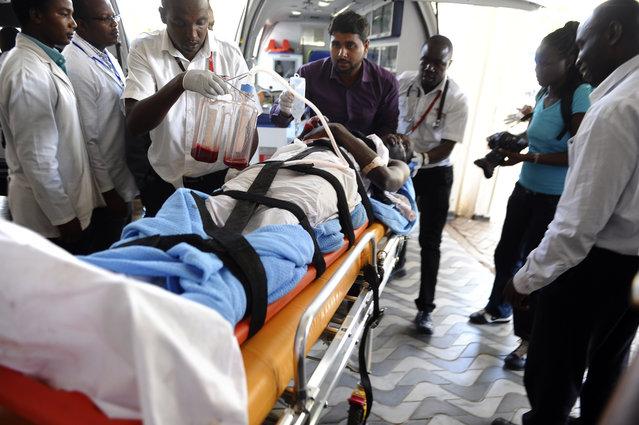 Medics help an injured person at Kenyatta national  Hospital in Nairobi, Kenya, Thursday, April 2, 2015, after being airlifted from Garissa after an attack by gunmen at Garissa University College in northeastern Kenya on Thursday morning. (Photo by AP Photo/Stringer)