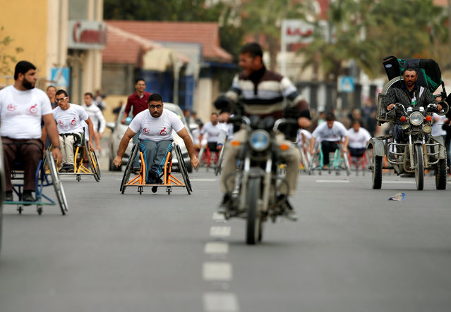 Disabled Palestinians compete during a local race organized by Assalama Charitable Society in Gaza City November 29, 2016. (Photo by Suhaib Salem/Reuters)