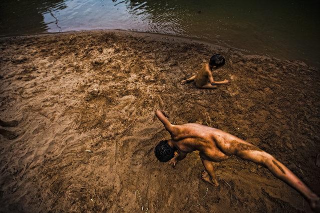 """Harmonic Children "". The childhood. Photo location: Vietnam. (Photo and caption by Antonio Gibotta/National Geographic Photo Contest)"