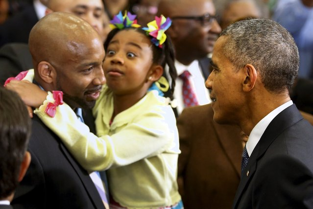 A little girl reacts with her father as U.S. President Barack Obama greets attendees after delivering remarks on the economy at Lawson State Community College in Birmingham, Alabama March 26, 2015. (Photo by Jonathan Ernst/Reuters)