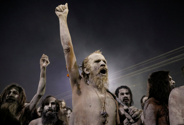 """Naga Sadhus or Hindu holy men leave after taking a dip during the first """"Shahi Snan"""" (grand bath) during """"Kumbh Mela"""" or the Pitcher Festival, in Prayagraj, previously known as Allahabad, India, January 15, 2019. (Photo by Danish Siddiqui/Reuters)"""