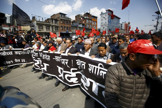 Chairman of the Unified Communist Party of Nepal (Maoist) Pushpa Kamal Dahal, also known as Prachanda, (C) along with senior leaders of various Maoist parties, takes part in a protest rally in Kathmandu April 6, 2015. According to the local media reports, Maoist parties took out a rally against the Supreme Court verdict that disallowed providing mass amnesty to those facing accusations for crimes during civil war. (Photo by Navesh Chitrakar/Reuters)