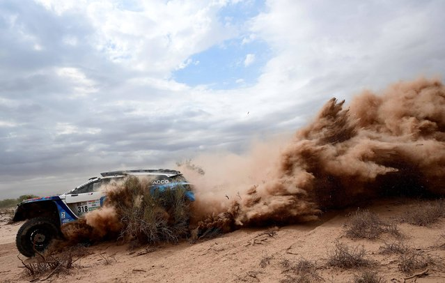 Peugeot's French pilot Romain Dumas and co-pilot Alain Guehennec compete during Stage 11 of the 2017 Dakar Rally between San Juan and Rio Cuarto, in Argentina, on January 13, 2017. (Photo by Franck Fife/AFP Photo)