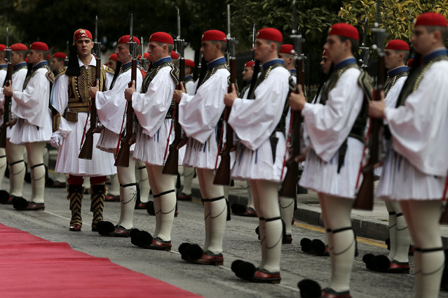 A Greek Presidential Guard captain inspects an honorary guard before the arrival of Italian President Sergio Mattarella at the Presidential Palace in Athens, Greece, January 17, 2017. (Photo by Alkis Konstantinidis/Reuters)