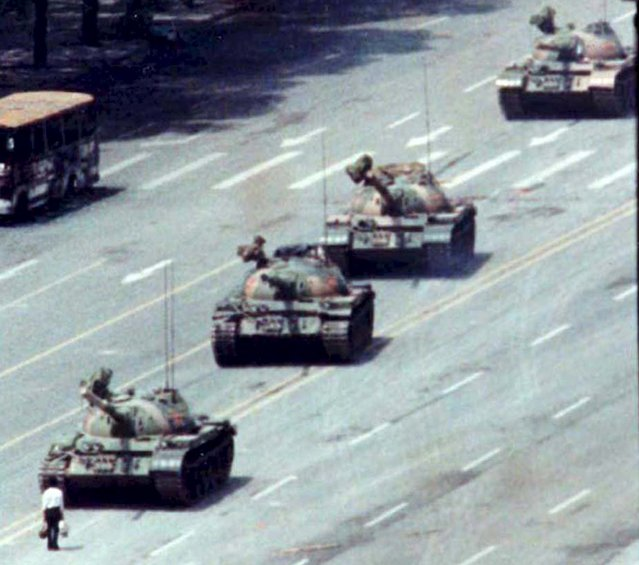 A Beijing citizen stands in front of tanks on the Avenue of Eternal Peace in this June 5, 1989 file photo during the crushing of the Tiananmen Square uprising. (Photo by Arthur Tsang/Reuters)