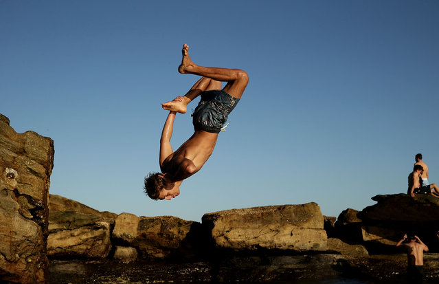A boy jumps into a rock pool in Coogee to cool off on February 25, 2016 in Sydney, Australia. The bureau of meteorology forecast temperatures over 40 degrees for parts of Sydney. (Photo by Mark Metcalfe/Getty Images)
