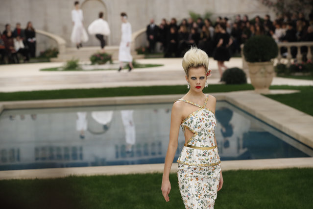 A model wears a creation for the Chanel Spring/Summer 2019 Haute Couture fashion collection presented in Paris, Tuesday January 22, 2019. (Photo by Christophe Ena/AP Photo)