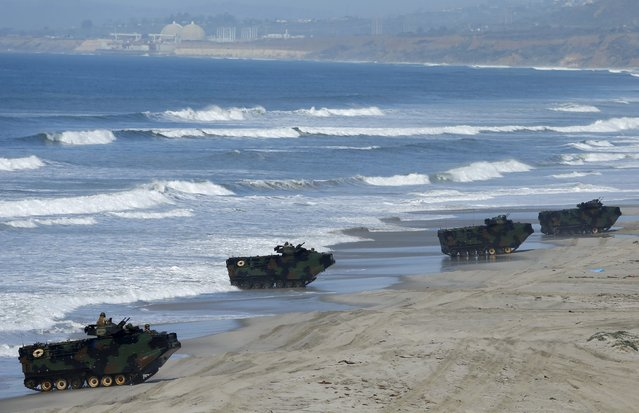 Soldiers from Japan's Ground Self Defense Force come ashore in amphibious assault vehicles as they train alongside U.S. Marines during the bilateral annual Iron Fist military training exercise in Camp Pendleton, California February 26, 2016. (Photo by Mike Blake/Reuters)
