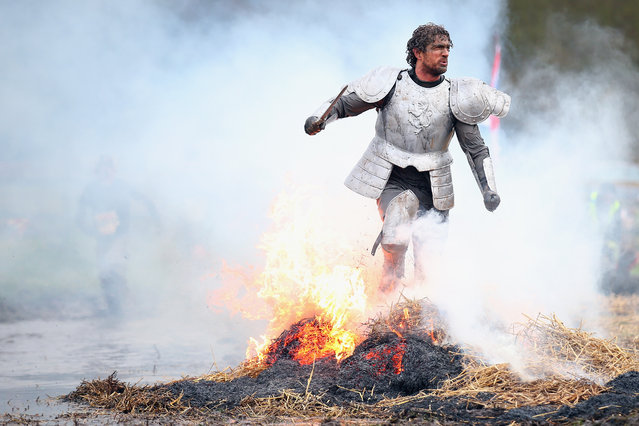 A competitor dressed as a knight runs through a fire during the Tough Guy Challenge on January 26, 2014 in Telford, England.  (Photo by Bryn Lennon/Getty Images)