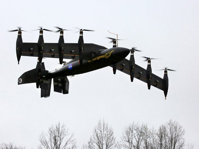 A prototype battery-powered plane, called Greased Lightning or GL-10 is pictured flying at NASA's Langley Research Center in this undated handout photo obtained by Reuters May 1, 2015. The plane, which has 10 engines and can take off like a helicopter and fly efficiently like an aircraft, is currently in the design and testing phase. (Photo by Reuters/NASA)