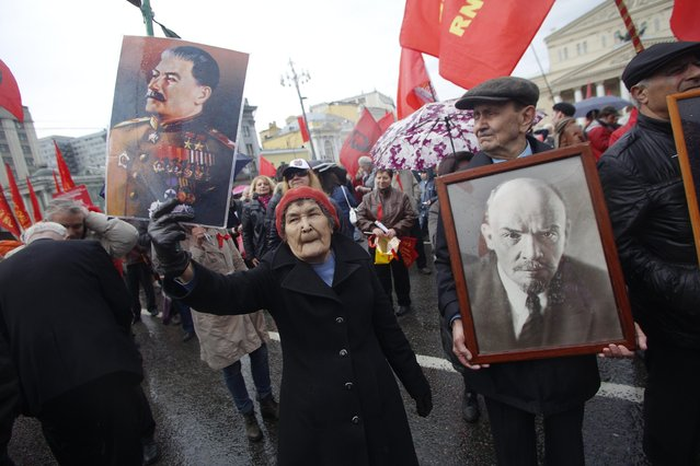 Communists carry portraits of former Soviet leaders Josef Stalin, left, and Vladimir Lenin as they march along Kremlin Towers during a May Day demonstration in Moscow, Friday, May 1, 2015. (Photo by Denis Tyrin/AP Photo)