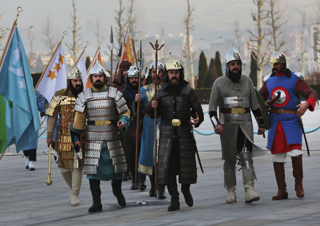 Members of Turkish military guard of honour in historical warrior gear, walk to take their positions prior to a welcome ceremony for Ethiopia's President Mulatu Teshome Wirtu, scheduled to meet Turkey's President Recep Tayyip Erdogan, at the Presidential Palace, in Ankara, Tuesday, February 7, 2017. (Photo by Burhan Ozbilici/AP Photo)
