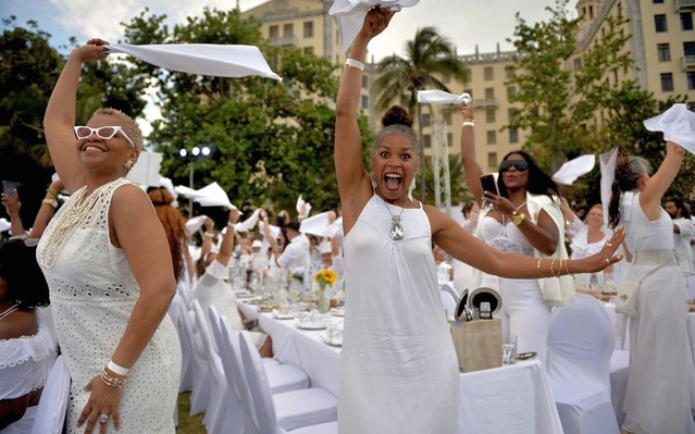 """Guests in white costumes attend the """"Diner en Blanc"""" event, at the Hotel Nacional in Havana on April 6, 2019. (Photo by Yamil Lage/AFP Photo)"""