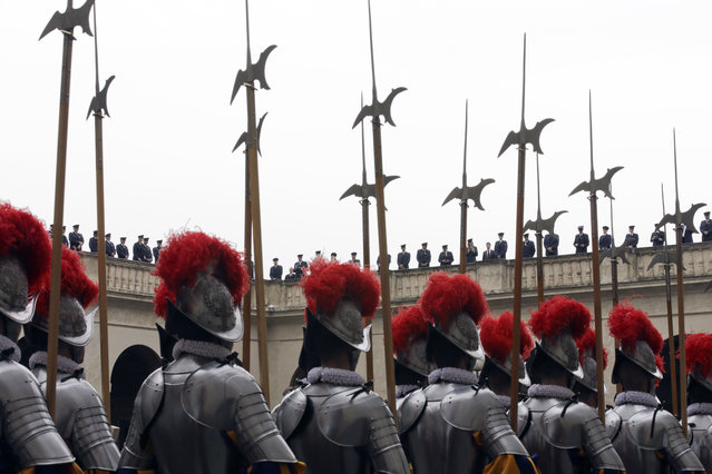 Vatican Swiss guards march on their way to a swearing-in ceremony, at the Vatican, Wednesday, May 6, 2015. (Photo by Alessandra Tarantino/AP Photo)