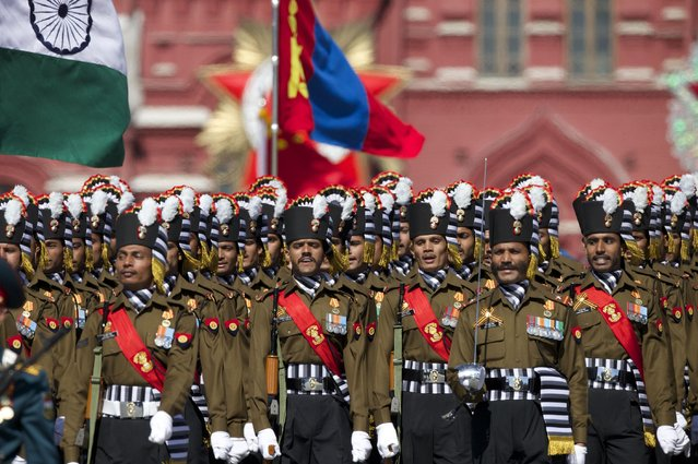 Indian army soldiers march along the Red Square during a general rehearsal for the Victory Day military parade which will take place at Moscow's Red Square on May 9 to celebrate 70 years after the victory in WWII, in Moscow, Russia, Thursday, May 7, 2015. (Photo by Ivan Sekretarev/AP Photo)